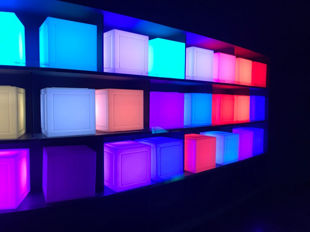 A wall with 3 rows of cubes, each glows a different color